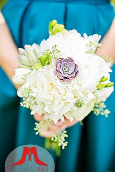 Closer shot of the adorable dusty purple succulent in this bridesmaid bouquet that pops against the peacock blue bridesmaid dress!