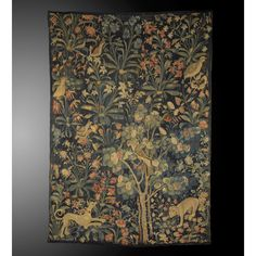 A SOUTH NETHERLANDISH `MILLE FLEURS' TAPESTRY FRAGMENT, CIRCA 1500-1530, AND LATER