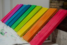 "DIY Rainbow Rocker (with template PDF) - Wood dyed with food coloring.  The ""wood dye"" was just a couple tablespoons of isopropyl rubbing alcohol mixed with about 20ish drops of food coloring. Just play with the ratio of food coloring to isopropyl alcohol until you get the color intensity you desire and brush it onto the wood with an interior paint brush. For the nine colors, I used two boxes of food coloring, one in the ""classic"" colors and one of the neon colors."