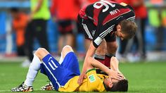 BELO HORIZONTE, BRAZIL - JULY 08: Philipp Lahm of Germany consoles Oscar of Brazil after Germany's 7-1 win during the 2014 FIFA World Cup Brazil Semi Final match between Brazil and Germany at Estadio Mineirao on July 8, 2014 in Belo Horizonte, Brazil... http://1502983.talkfusion.com/products/