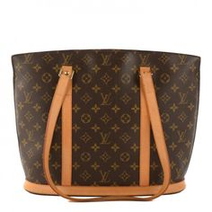 675639eac7117 This is an authentic LOUIS VUITTON Monogram Babylone. This large tote bag is  crafted of