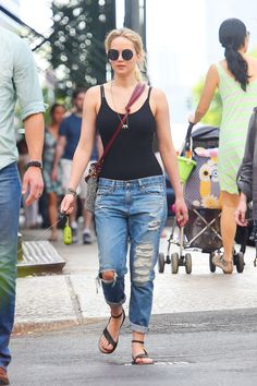 Jennifer Lawrence enjoys a laid back Memorial Day Weekend, hitting the streets in perfectly distressed boyfriend jeans with a black tank, and her Elizabeth & James basket weave cross-body for a bohemian touch.   - HarpersBAZAAR.com