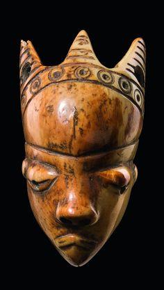 "Africa | Anthropomorphic amulet mask ""ikoko"" from the Pende people of DR Congo | Ivory; shiny patina | Est. 2000 - 3000 € ~ (June '14)"