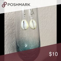 NWT 🌺 Cowrie shell earrings Cowrie shell earrings, off white. Slight variations in color and size may occur. Silver plated. Hand made and designed by me. Jewelry Earrings