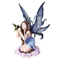 Fairy With Hummingbird  Price $84.99