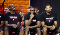 From left, Miami Heat's Jarvis Varnado, Dwyane Wade and Juwan Howard watch a video after LeBron James was awarded his fourth Most Valuable Player trophy during an NBA basketball news conference, Sunday, May 5, 2013, in Miami. J Pat Carter / AP Photo