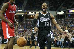 Nov 29, 2013; Sacramento, CA, USA; Sacramento Kings forward Derrick Williams (13) reacts after a dunk against Los Angeles Clippers center De...
