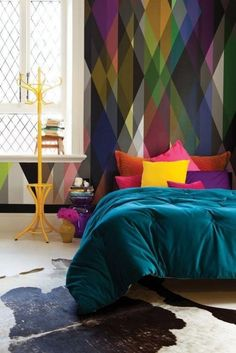 2017 interior design trend: Jewel tones. With Greenery announced as Pantone's colour of 2017, we're going to see a lot more green in the high street and this calls for strong colours to accessorise with. Jewel tones fit this perfectly. They'll look bright and modern with green and lift a neutral interior. Photo: lovechicliving.co.uk