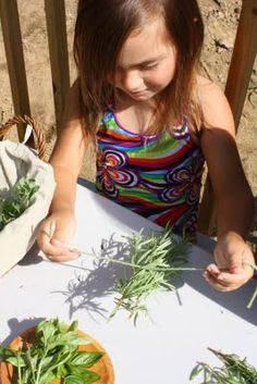 Tying Herbs at Little Acorn Learning