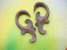 natural organic body jewelry wooden ear stretcher - http://www.wholesalesarong.com/blog/natural-organic-body-jewelry-wooden-ear-stretcher/