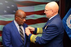 "Coast Guard Commandant Adm. Bob Papp presents Al Roker the Meritorious Public Service Medal at Coast Guard Headquarters in Washington Aug. 21, 2012. Roker and staff members of Al Roker Entertainment received the award for exceptional advocacy of the Coast Guard through broadcasts of The Weather Channel's popular primetime series ""Coast Guard Alaska."" U.S. Coast Guard photo by Petty Officer 2nd Class Patrick Kelley."