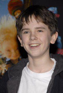 Freddie Highmore as a kid