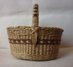 1:12th Scale Dollhouse Miniature Oval Shopping Basket. It is made using wire for stakes and waxed linen for weavers.