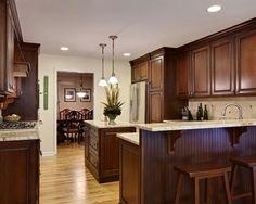 Rich dark cabinets w blonde hardwood floors and granite countertops #home #remodel #kitchen #bathroom #interiors  www.jimhicks.com