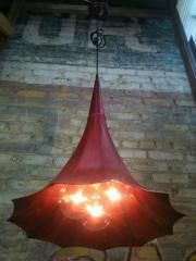 Re-purposed phonograph horn / chandelier.  Great light fixture & conversation piece.