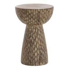 H: 53.34cm Dia: 35.56cm  This solid natural mango stool or accent table has been hand-carved to give it a surface texture that adds dimensionality. Place this organic element in a transitional room and embrace the juxtaposition of the styles.  Dimensions:   	Overall Dimension H: 21 	Overall