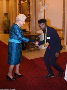 Boxer Nicola Adams gave her best curtsey when she met the Queen at the Buckingham Palace event today