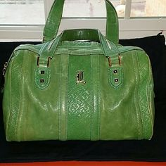 L.A.M.B. green capri satchel Bought this bag at a different site. It's not what i was expecting. The inside looks very clean. Corners have minimal wear. No piping. Bag does show some discoloration as the green it's not as bright. Leather can be dyed and it will look good as new (I just don't have the time for it). Bag is also missing the tassel and lock. This is a medium size bag. If you need more pictures please let me know. L.A.M.B. Bags Satchels