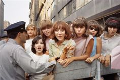 Beatles fans wait on a New York street for a chance to glimpse their idols