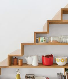 A closer look at the shelving built into the staircase in the kitchen - Kathryn Tyler's home from Grand Designs