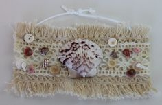 item #B085 The leather and lace wrap- is made of a combination of lace, seashells and pukas all sewn to make one glorious wrap bracelet.