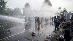 Refugee crisis escalates as migrants break through Hungarian border | World news | The Guardian