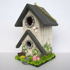 This little birdhouse is 5 tall, 3 1/2 wide and 2 3/4 deep. There is a cute little Mouse checking out a wedge of cheese in the front yard and a