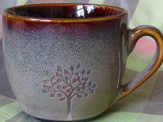 """reCYCLEd espresso cup with leafy tree. This is a ceramic espresso cup that I reCYCLEd by sand carving one of my drawings of a tree on the side. The image is sandblasted right through the glaze revealing the clay underneath. The cup is 2.5"""" high and 2.5"""" in diameter. This cup appears to be brand new even though I bought it in a second hand shop. - reCYCLEceramics on Etsy"""