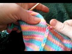 """Knitting Strips Together -- Tutorial Demonstration of technique used for Patches Baby Sweater, in book """"Sock Yarn One-Skein Wonders"""" by Judith Durant. Video ..."""