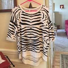 Willow & Clay Zebra Top Willow & Clay Zebra Top. Very cute top. In very good condition. The details on the hem are beautiful. The sleeves are 3/4. Beautiful top Willow & Clay Tops Sweatshirts & Hoodies