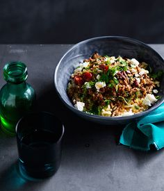 Lamb with orzo and olives recipe - Heat olive oil in a large frying pan over medium-high heat, add lamb and brown well all over, breaking up any clumps with a wooden spoon (2-3 minutes).