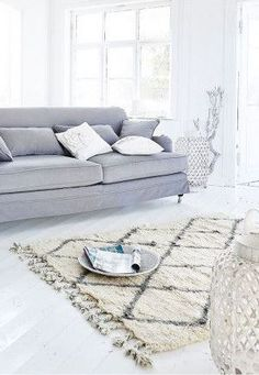 No coffee table- space for yoga- and perhaps an ottoman or a rolling table to bring in, when needed? ~w