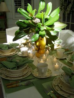 A Magnolia & Lemon Centerpiece  http://betweennapsontheporch.net/a-magnolia-lemon-centerpiece-welcome-to-the-11th-tablescape-tuesday/#