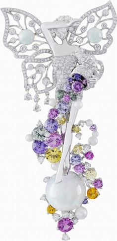 Fortuna clip, Palais de la chance collection, Van Cleef & Arpels: white gold, diamonds, white opals, colored sapphires, white cultured pearls, rose-cut diamond face. – photo via Van Cleef & Arpels