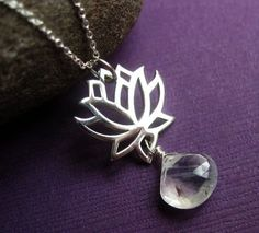 Hey, I found this really awesome Etsy listing at http://www.etsy.com/listing/56842159/lotus-flower-and-gemstone-necklace