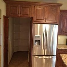 hidden pantry behind the fridge..awesome! Gotta have!