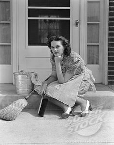 1930S 1940S Woman Housewife Sitting On Front Door Step Surrounded By Household Cleaning Tools Thinking Or Worrying About Future