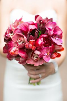 tropical bouquet filled with orchids, peony, calla lily
