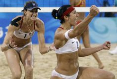 Women outnumber men on the US Olympic Team in London this year! SUPER HEROS! This is U.S. beach volleyball stars Kerri Walsh (left) and Misty May-Treanor, pictured here during the Beijing Games, are seeking their third Olympic gold medal. (AP Photo/Natacha Pisarenko, File)
