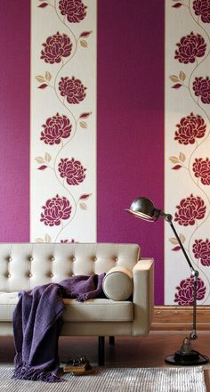 I love the idea of alternating solid color wallpaper strips with a floral patterned one!