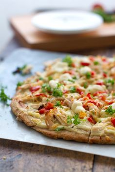 Healthy version of chicken Alfredo pizza. Whole wheat crust, creamy cauliflower sauce, 150 calories a slice