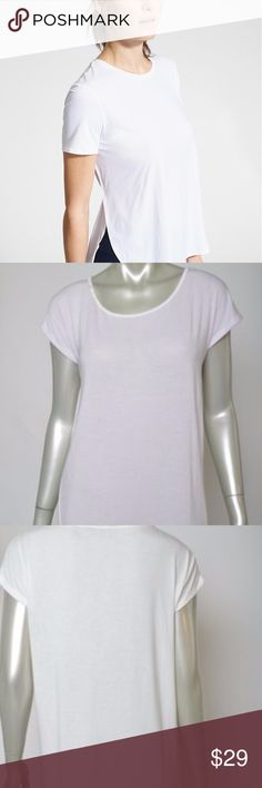 Athleta Shirt Light Lavender Front White Back S Athleta Shirt Small Light Lavender Front White Back Casual Yoga Top sz S Front of the shirt is a very light lavender. Back is white. Excellent Condition. Total length is 28.5 inches.  Bust is 42 inches, unstretched Athleta Tops Tees - Short Sleeve