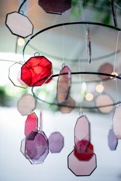 stained glass mobile - photo by Jessica Hill Photography http://ruffledblog.com/plum-toned-stained-glass-wedding