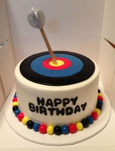 Frosted cake with fondant archery target. Arrow made of dowel with gumpaste feathers.