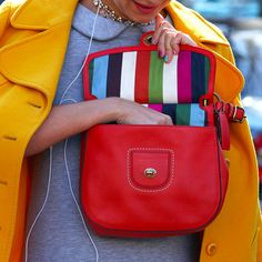 Photo courtesy of Phil Oh - where to start?!  Oh, the bag... the nails, the yellow coat, the hot pink lips - love it all.