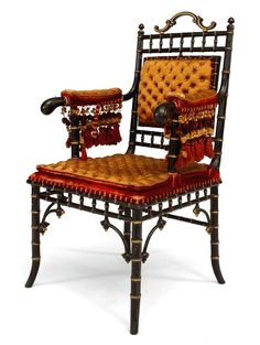 French Victorian faux-bamboo design ebonized and gilt-trimmed armchair.