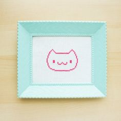 Make a super quick cross stitch cat with this free pattern!