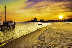 The Mississippi Gulf Coast, often referred to as the Southern Riviera is know for its sun and surf and of course the casinos that dot the coastline. The setting sun can put on quite a show, turning the sand to gold.