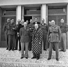 Winston Churchill, recovering from a bout of pneumonia, with General Eisenhower (left), General Sir Henry Maitland-Wilson (right) and other miltary chiefs, 25 December 1943.