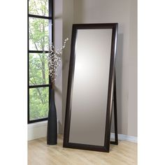Set up this full-length mirror to keep an eye on your appearance.